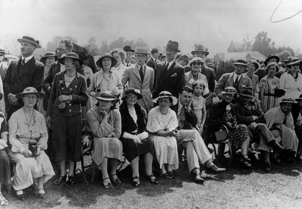 A rather snobbish looking group of spectators, well-to- do parents and relatives of boys taking part in the games on Sports Day at Cheltenham Boys College, Glos., England. Date: 1929