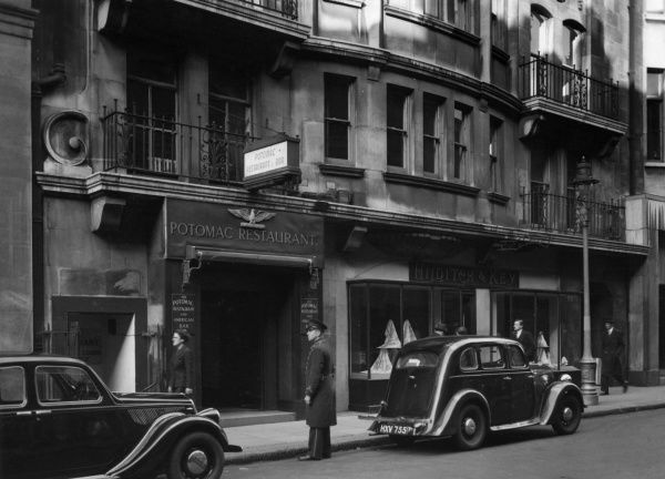 Exterior of the Potomac restaurant and American bar on Jermyn Street in London, next to Hilditch & Key, shirt makers. Date: 1947