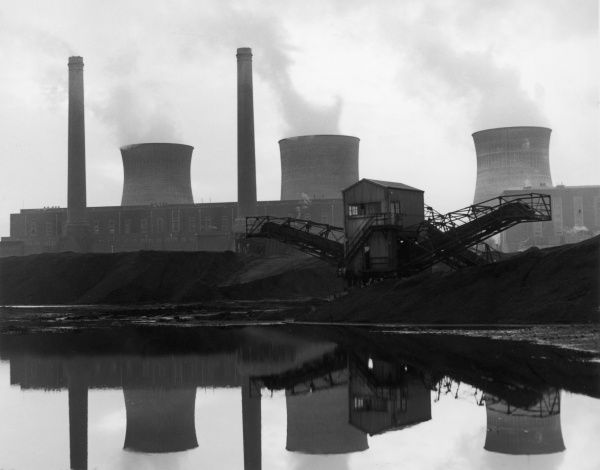 An industrial landscape in Britain, showing power plant with cooling towers in the background
