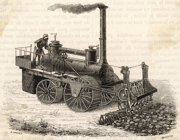 A mechanical steam-powered digger by the M.M Barrat brothers is used to break the ground in preparation for a road to be constructed