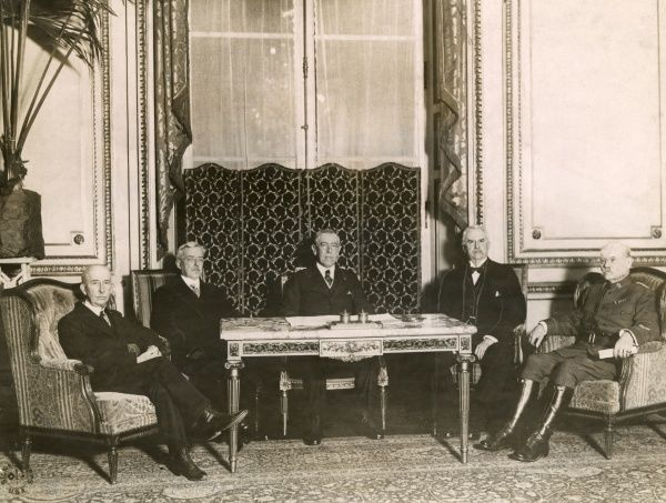 The American President Thomas Woodrow Wilson (1856-1924), seen here (centre) at the Peace Conference, Hotel Crillon, Paris, following the end of the First World War. With him, from left to right, are Colonel E M House (diplomat and adviser)