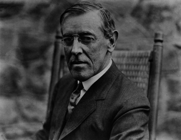 Thomas Woodrow Wilson (1856-1924), seen here sitting in a rocking chair in the year he was elected 28th President of the United States (he served officially from 1913 until 1921). Date: 1912