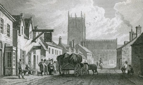 A wagon parks outside a pub in a street in Preston, Lancashire Date: 1829