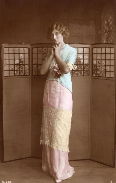 Pretty girl standing in front of a beautiful stylised screen Date: 1912