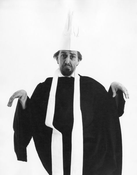 A limp-wristed priest (or chef)! Date: 1960s