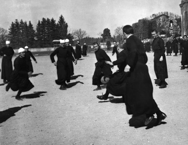 A group of young Italian priests playing a game of football, Rome, Italy. Date: 1930s