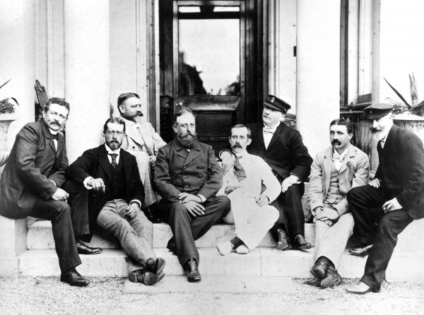 Prince Henry (Heinrich) of Prussia (1862-1929), with Alfred von Tirpitz (1849-1930), German naval commander, and others, mainly British, sitting on some steps at the Royal Yacht Club in Queenstown, Ireland
