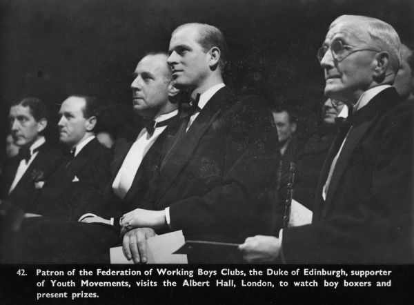 Prince Philip, Duke of Edinburgh pictured at the Albert Hall, London in his capacity as Patron of the Federation of Working Boys Clubs, to watch boy boxers and present prizes. c.1953