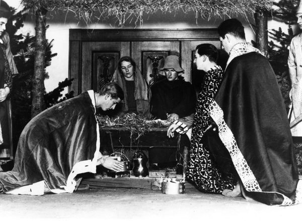 Prince Philip of Greece, later Prince Philip, Duke of Edinburgh (born 1921), pictured playing one of the three kings in the Oberufer nativity play, while at Gordonstoun school in 1938. Prince Philip can be seen laying his crown before the cradle