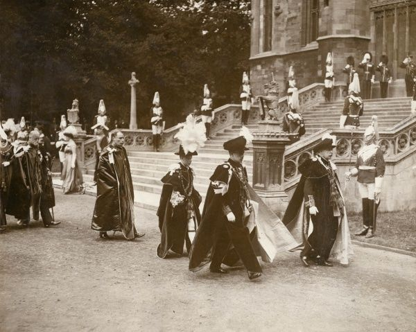 The Prince of Wales (later Edward VIII and Duke of Windsor) invested as Knight of the Garter. Seen here at the centre of the photograph, wearing a large plume of white feathers, leaving St George's Chapel, Windsor, preceded by the Duke of Connaught
