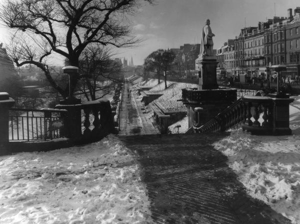 Winter in Edinburgh, Midlothian, Scotland. Looking across West Princes Street Gardens, with Princes Street behind the statue of Allan Ramsay. Date: 1960s