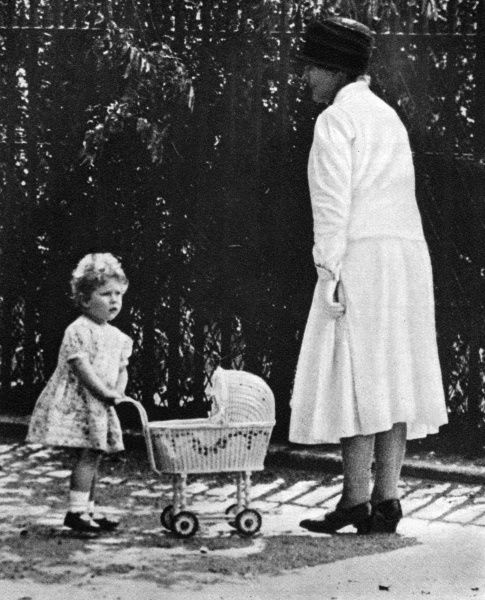 Princess Elizabeth plays with a toy pram in the grounds of 145, Piccadilly. 1936