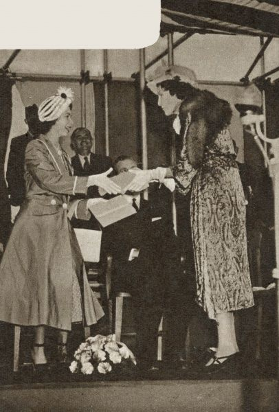 Princess Elizabeth accepting a casket from Winifred Duchess of Portland after laying the foundation stone of the main building of the Portland Training College for the disabled