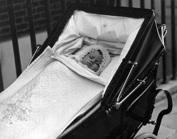 Princess Elizabeth of York (now Queen Elizabeth II), lying in her pram at around five months old, 1926. Date: 1926