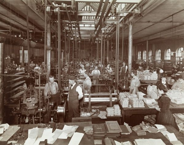 American Type Founders Co. Employees working on various parts of the printing press