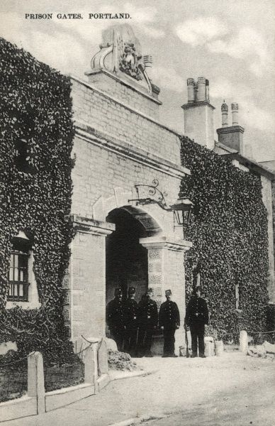 Uniformed officers stand at the entrance to Portland Prison, Dorset. The prison opened in 1848 as a public works prison for convicts who were employed in quarries in the area