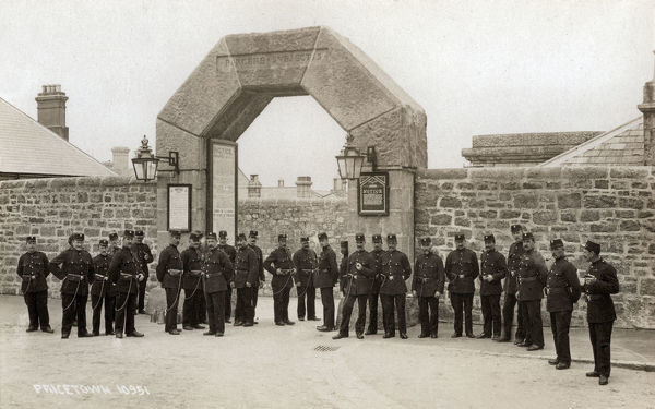 Uniformed prison officers stand at the main gate of Dartmoor Prison, Princetown, Devon. The prison was originally constructed in 1806-9 to hold French prisoners taken during the Napoleonic wars