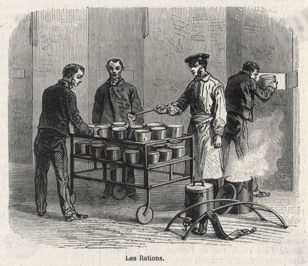 Serving food from a trolley in La Conciergerie prison, Paris - the pans are handed in through the cell doors