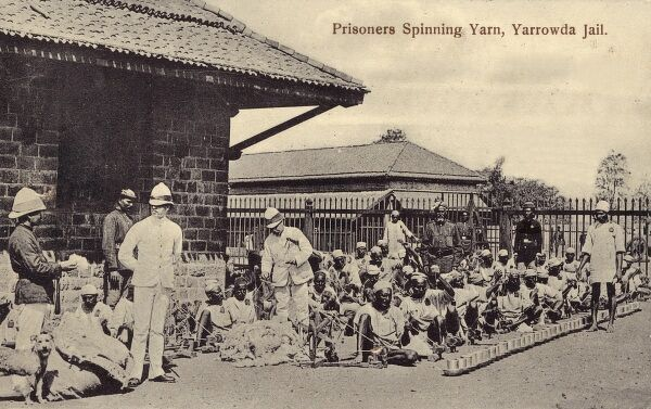 Prisoners spinning yarn - Yerwada Jail, Pune, India (Gandhi was imprisoned here for a time, spinning thread whilst imprisoned). Date: circa 1908