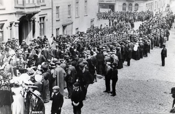 A special occasion in the High Street and Castle Square area of Haverfordwest, Pembrokeshire, Dyfed, South Wales, possibly for the unveiling of a memorial to Boer War soldiers. A group of dignitaries in top hats, together with rows of policemen