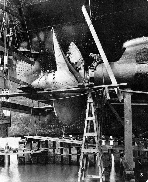 Photograph of one of the propellors of R.M.S. 'Queen Mary', then nearing completion in the John Brown Shipyard, Clydebank. The ship was christened and launched by Queen Mary on 26 September 1934