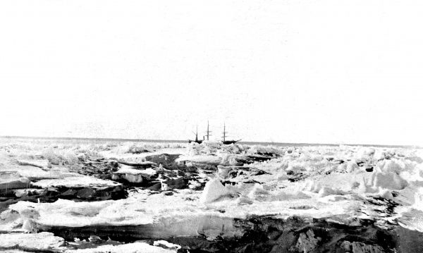 Photograph of Polar Research Ship 'Discovery', in the pack ice of McMurdo Strait, 7th February 1902. 'Discovery' was used during the National Antarctic Expedition of 1901-04