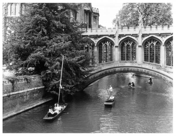 Punting on the Cam (also known as the Granta) on the Backs at Cambridge ; the famous Bridge of Sighs (modelled on the one in Venice) links parts of St John's College