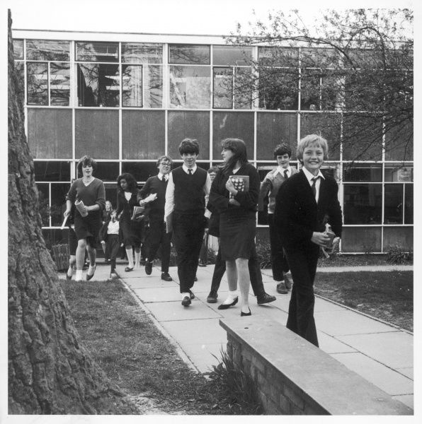 Pupils coming out of school at Holmshill Middle School in Borehamwood, Hertfordshire