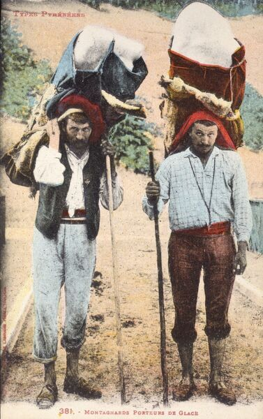 Pyrenean Mountain Men carrying large blocks of ice on their heads, France Date: circa 1910s