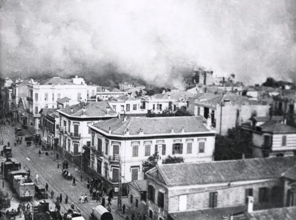 Aerial view of the quay on fire at Salonika (Salonica, Thessaloniki, Greece) during the First World War, with people in the streets in the foreground. Date: August 1917