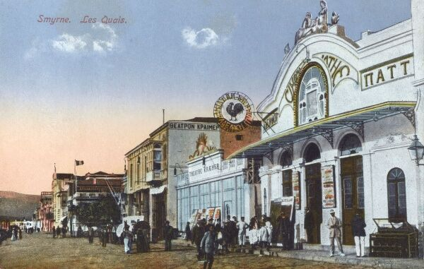The Pathe Cinema with its emblem of a Cock. The building next the cinema is the Kramer Theatre - at Izmir, Turkey. circa 1910s