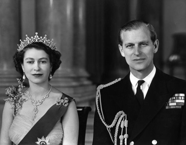 Queen Elizabeth II and Prince Philip, Duke of Edinburgh pictured together in the Grand Entrance in Buckingham Palace in 1954