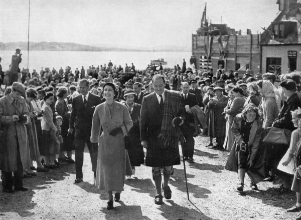 The first reigning monarch to set foot on Iona for nearly a thousand years, Queen Elizabeth II, accompanied by Sir Charles Maclean is followed by Prince Philip and Princess Margaret as she walks from the jetty to the Abbey of Iona