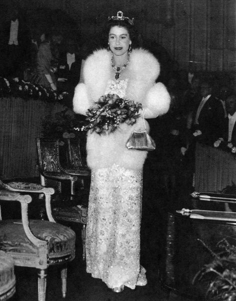 Queen Elizabeth II looking sumptuous in a beaded evening gown and fur wrap. The event was the Royal Film Performance at the Odeon Theatre in Leicester Square, London. 1957