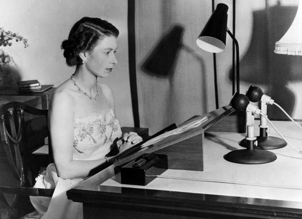 H. M. The Queen seated at the microphone making her Christmas broadcast from Government House, Auckland in 1953. Date: 1953