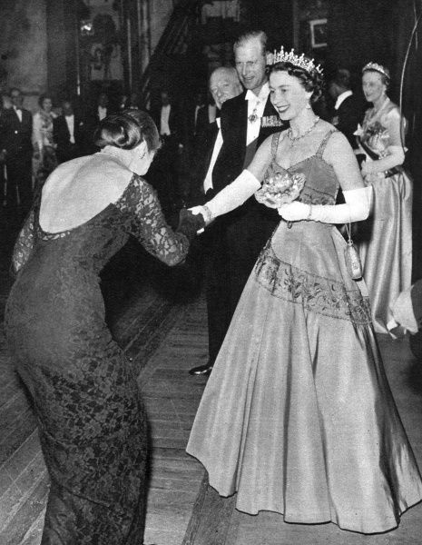 Opera singer Maria Meneghini Callas makes her curtsey as she meets Queen Elizabeth II after singing a scene from Bellini's opera, I Puritani, part of a programme in a gala evening marking the centenary celebration of Covent Garden Theatre