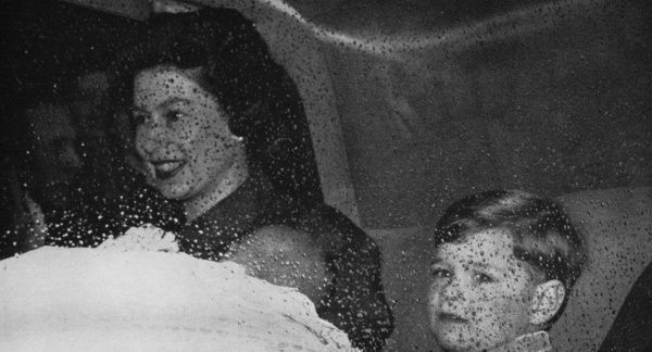 Queen Elizabeth II leaving London for Windsor Castle with her fourth child, the newborn Prince Edward, and Prince Andrew on her first public appearance since the baby was born. Date: 1964