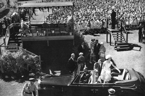Queen Elizabeth II and Prince Philip leave Victoria Park racecourse, Adelaide, after a choir of 3000 children sang Australian songs. Another 70,000 children attended the occasion. Date: 1963