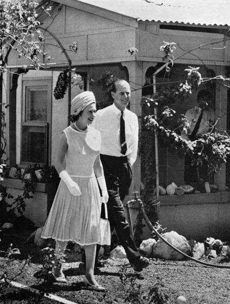 Queen Elizabeth II and Prince Philip leaving the home of Mrs Elsie Jenkins in Alice Springs after viewing her famous collection of opals. Date: 1963
