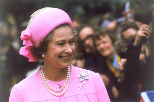 Queen Elizabeth II, a vision in pink, beams as she is greeted by crowds on a royal walkabout in London for the Silver Jubilee, 1977. Date: 01/07/1977