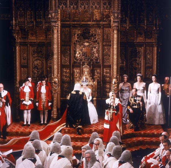 Queen Elizabeth II in full regalia at the State Opening of Parliament in 1964. Date: 1964