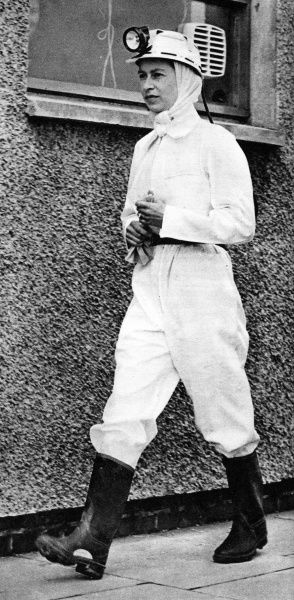Queen Elizabeth II dressed in protective white overalls to make her first descent into a coal-mine at Rothes Colliery, Fife, Scotland in 1958
