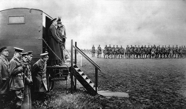 Queen Mary, accompanied by Prince Albert (later George VI) and Princess Mary, at an inspection of troops near Aldershot, Hants. While on a visit to the Western front in 1915, George V fell from his horse and broke his pelvis. During his recuperation