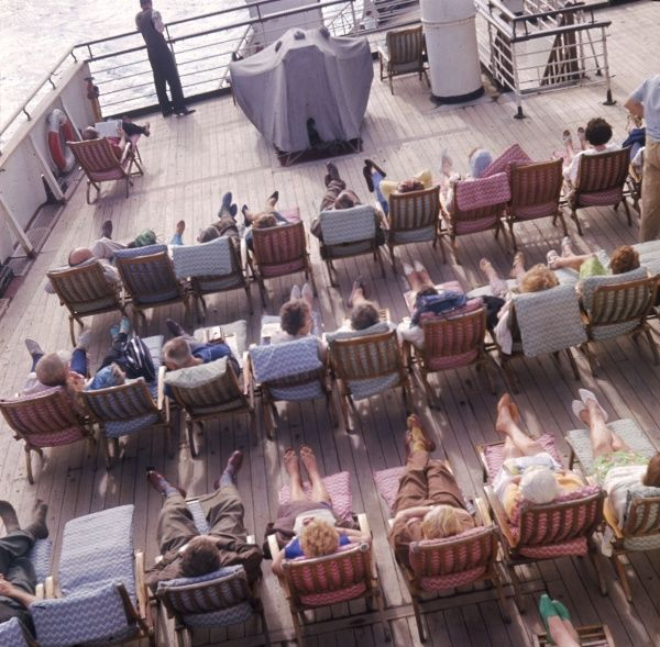 Lucky passengers relaxing on the stern deck of the Cunard White Star Liner 'Queen Mary', on one of her last voyages. Date: launched 1934