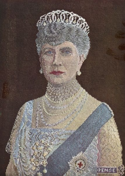 A portrait of Queen Mary, consort of King George V, worked in petit point specially for The Queen magazine, Silver Jubilee issue by the Disabled Soldiers Embroidery Industry of which her Majesty was the royal patron