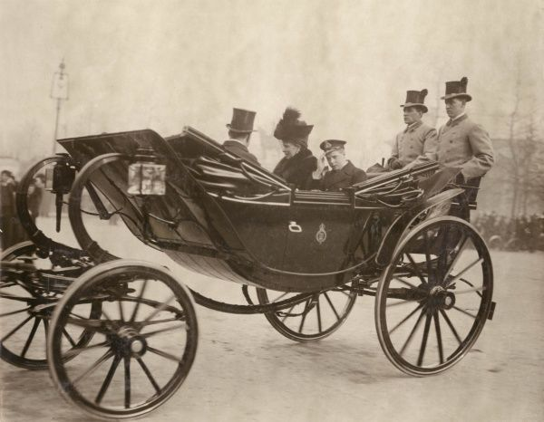 Queen Mary and the Prince of Wales (later Edward VIII) in an open carriage on their way to a royal visit to Kensington
