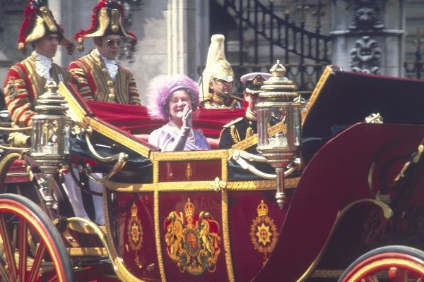 Elizabeth, the Queen Mother, photographed waving to the crowds from the Royal Carriage, on her 80th birthday (4 August 1980). Date: 1900 - 2002