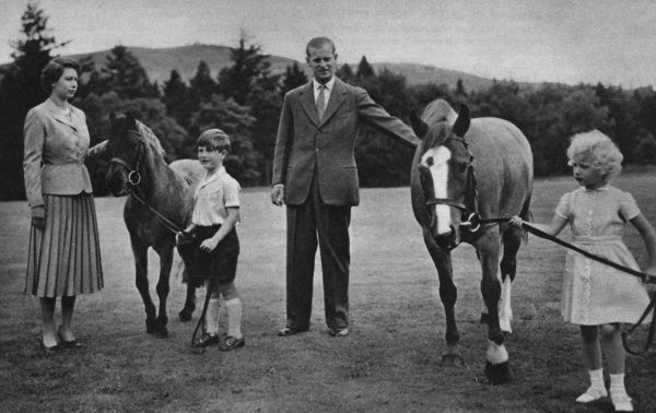 Prince Charles leading his pony William to his mother, Queen Elizabeth II. Princess Anne hold Greensleeves, patted by the Duke of Edinburgh, at Balmoral. 1955