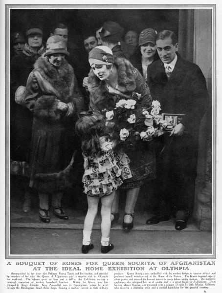 QUEEN SOURIYA OF AFGHANISTAN pictured receiving a bouquet at the Ideal Home exhibition in London during a visit by King Amanullah and herself in March 1928. Accompanied by