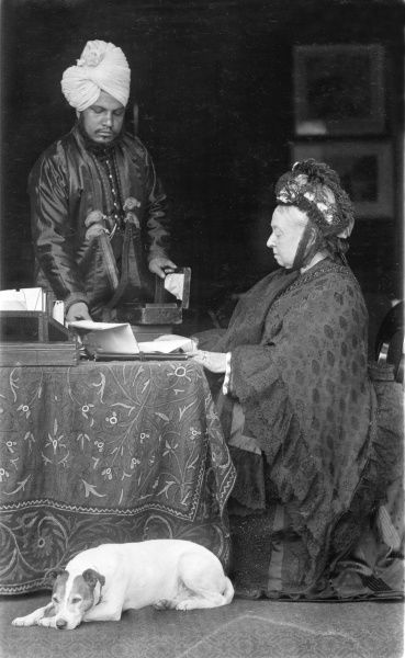 Queen Victoria at her desk, assisted by her servant Abdul Karim, the 'Munshi&#39